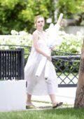 Elle Fanning wears a flowing white dress as she heads out in Los Angeles