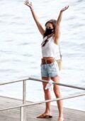 Emilia Clarke seen wearing denim shorts and white top while out for lunch with friends in Positano, Italy