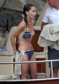 Emilia Clarke spotted in a striped bikini as she enjoys her summer holiday with friends in Positano, Italy