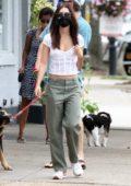 Emily Ratajkowski and Sebarstian Bear-McClard step out to walk their dog after having lunch in Sag Harbor, New York