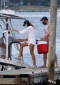 Emily Ratajkowski and Sebastian Bear-McClard ferried in the Sag Harbor launch to a large boat in Sag Harbor, New York