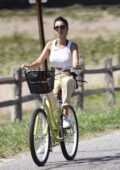 Emily Ratajkowski enjoys a bike ride in the Hamptons, New York