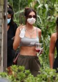 Emily Ratajkowski flaunts her toned midriff in a crop tank top while getting lunch at a local restaurant in the Hamptons, New York