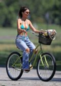 Emily Ratajkowski goes for a bike ride after enjoying the beach in The Hamptons, New York