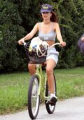 Emily Ratajkowski is all smiles as she rides her bike to the beach for a photoshoot in the Hamptons, New York