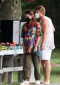 Emily Ratajkowski stops to buy fruit and vegetables with her husband in the Hamptons, New York
