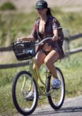 Emily Ratajkowski wears a cover-up over her black bikini while enjoying a bike ride in The Hamptons, New York