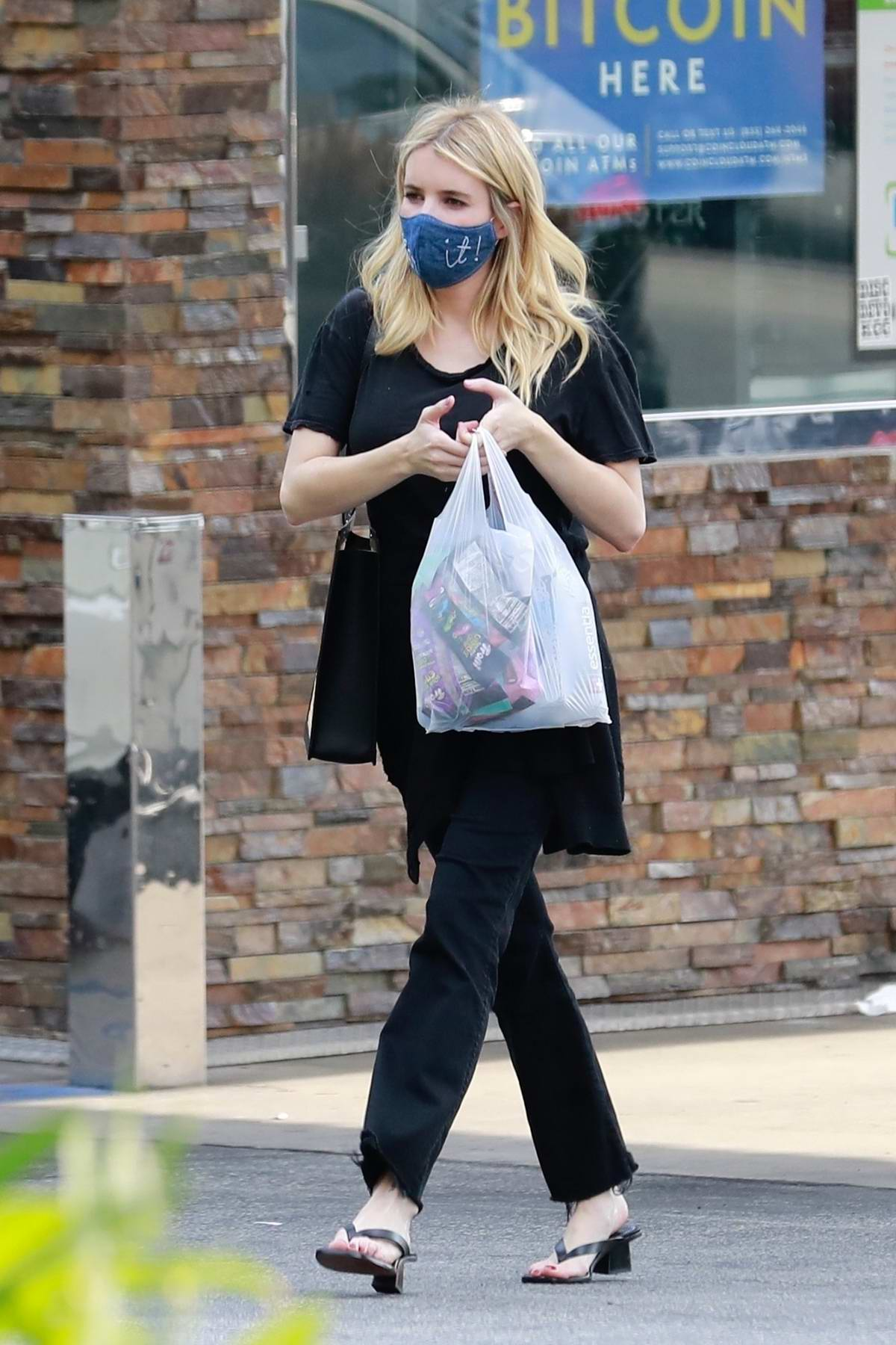 Emma Roberts spotted in all-black ensemble while picking up some sweets at a gas station in Los Feliz, California