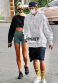 Hailey Bieber and Justin Bieber pack on some PDA while waiting in line for a table in West Hollywood, California