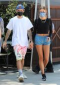 Hailey Bieber flashes her toned legs in tiny blue shorts while out to lunch with Justin Bieber in West Hollywood, California
