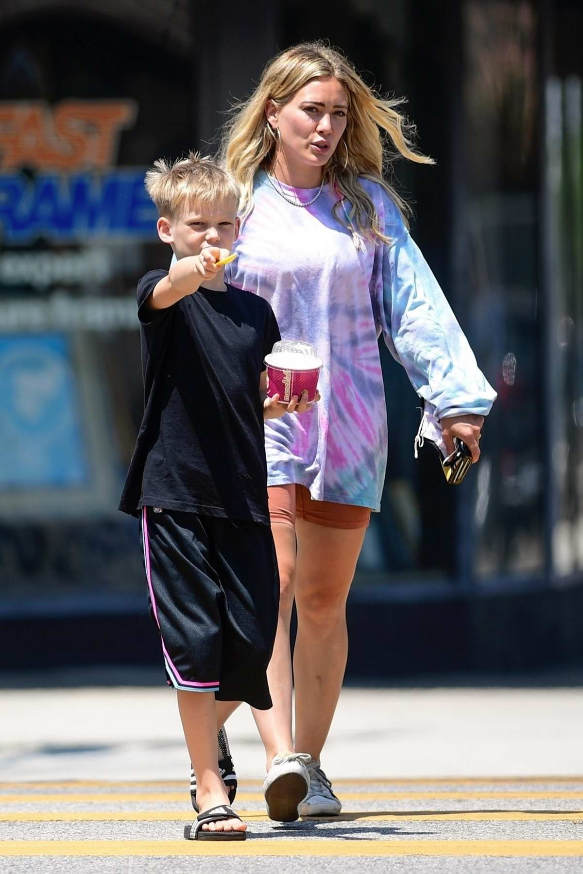 Hilary Duff takes her son out for a cold treat at Menchie's Frozen Yogurt during a play date with friends in Los Angeles