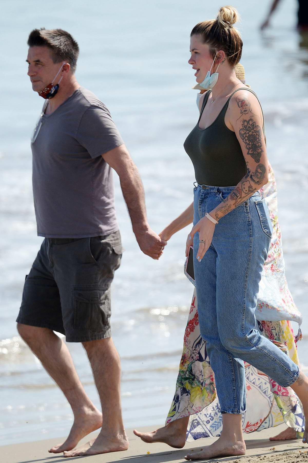 Ireland Baldwin and her uncle Stephen Baldwin cool off in the ocean in Malibu, California