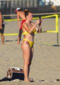 Ireland Baldwin looks striking in a yellow bikini while at the beach with boyfriend Corey Harper in Malibu, California