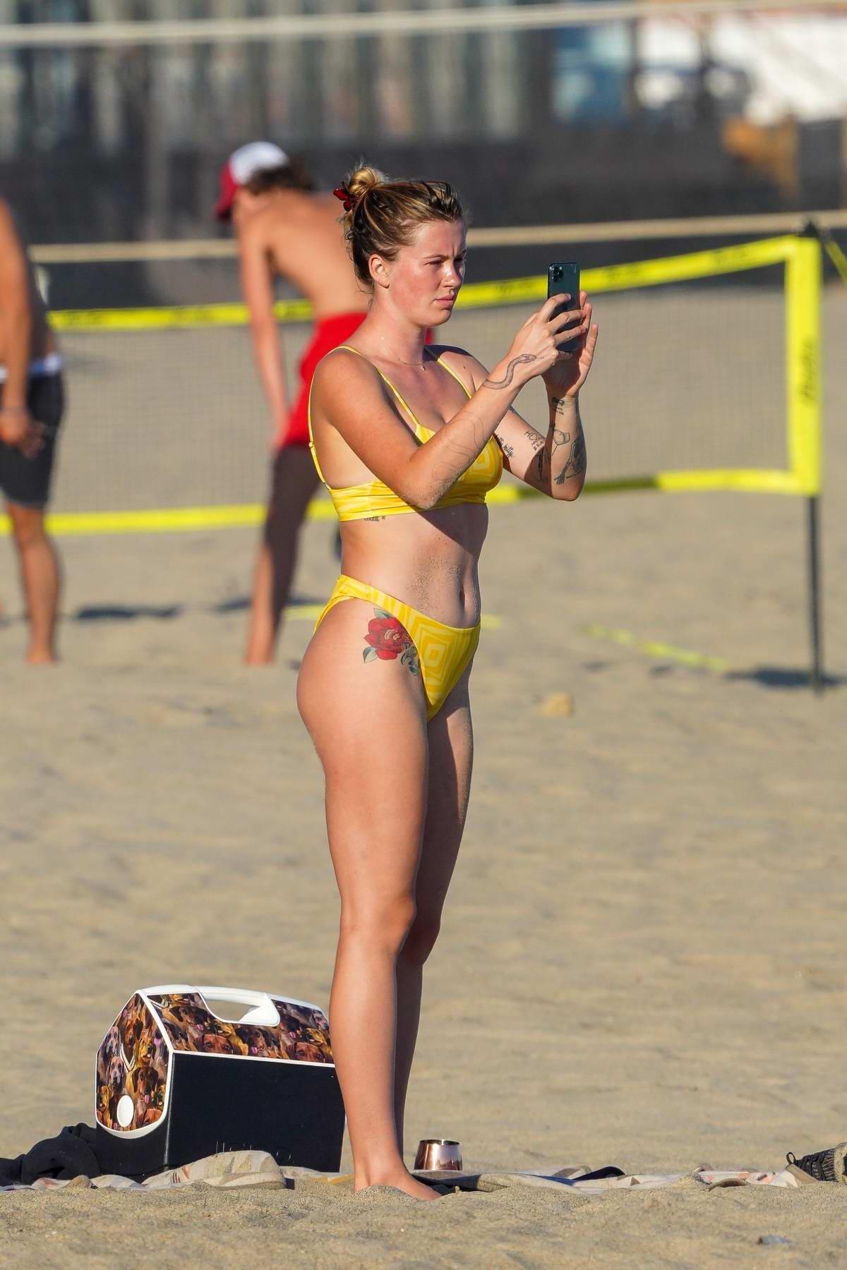 Ireland Baldwin looks striking in a yellow bikini while at the beach with boyfriend Corey Harper in Malibu, California