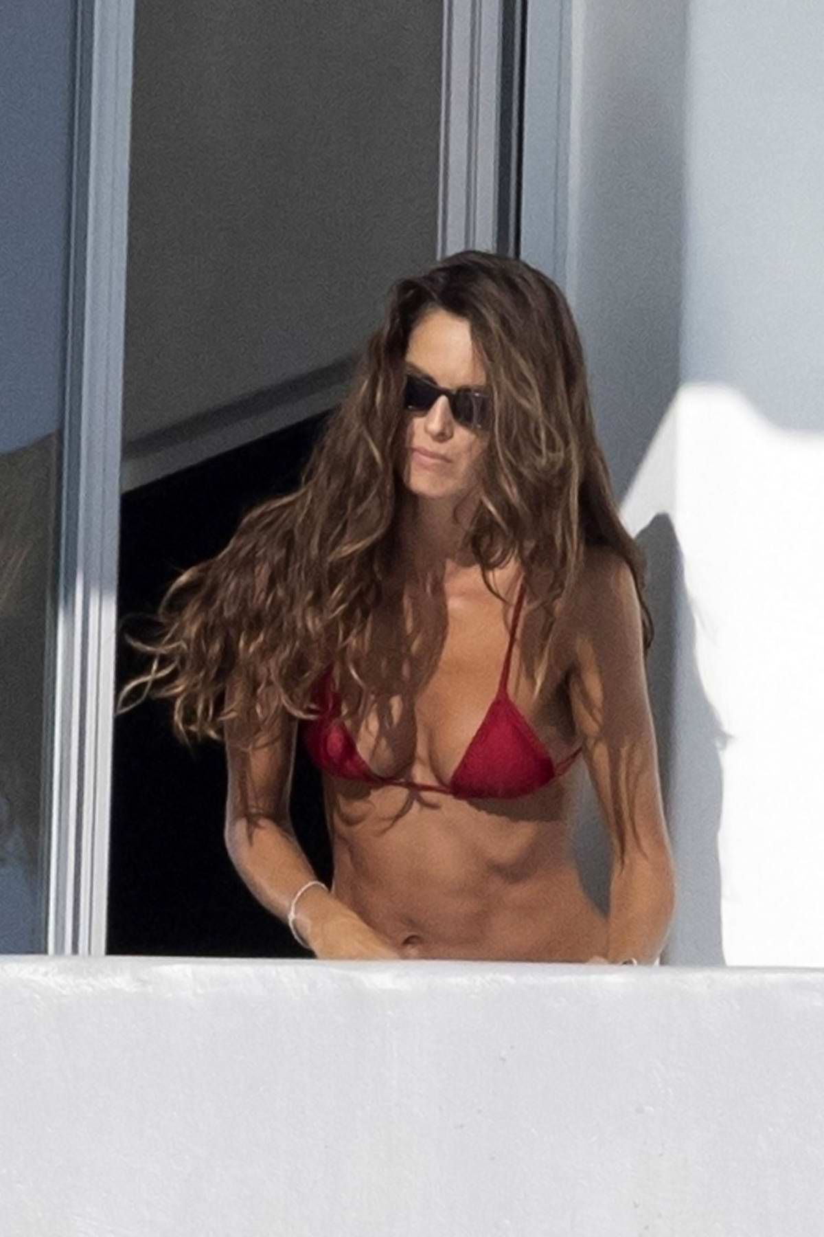 Izabel Goulart and Kevin Trapp soak up the sunshine at the hotel during their holiday in Mykonos, Greece