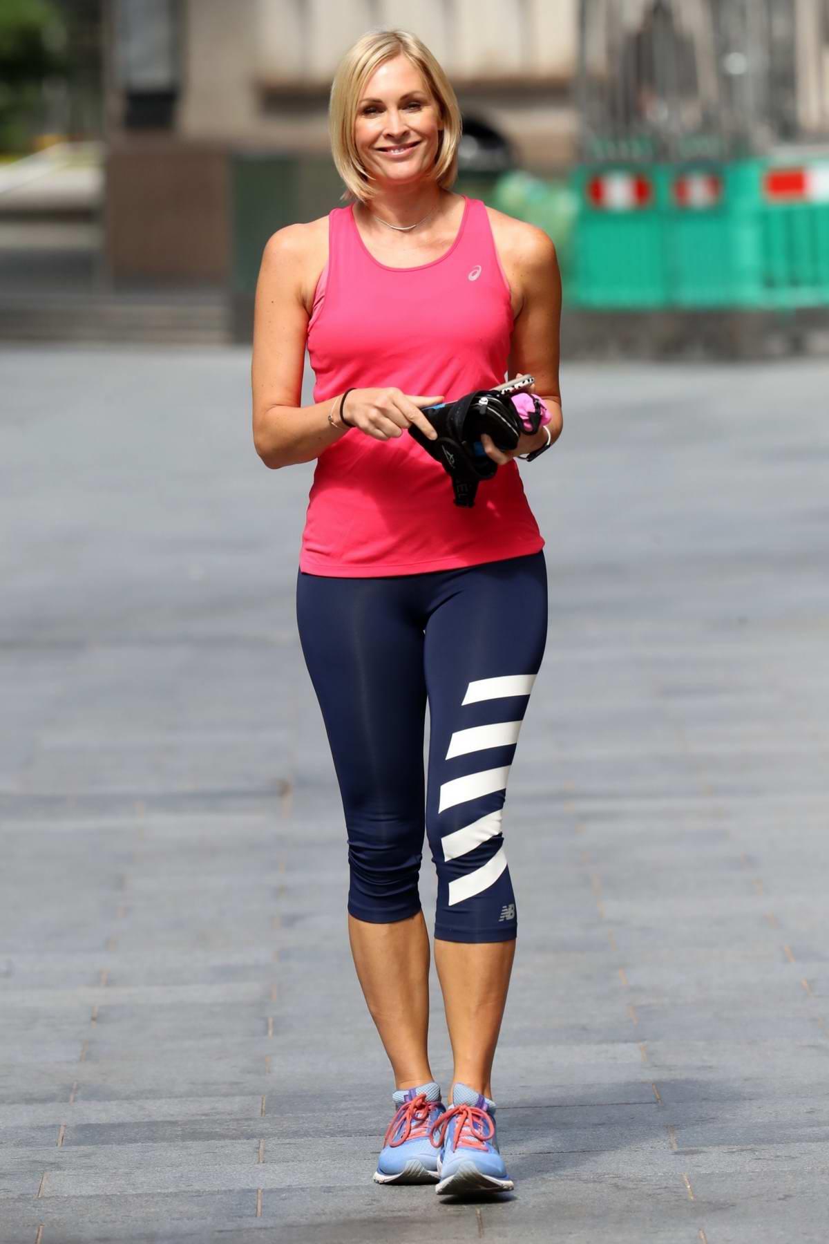 Jenni Falconer sports pink tank top and navy leggings as she leaves the Global Radio studios in London, UK