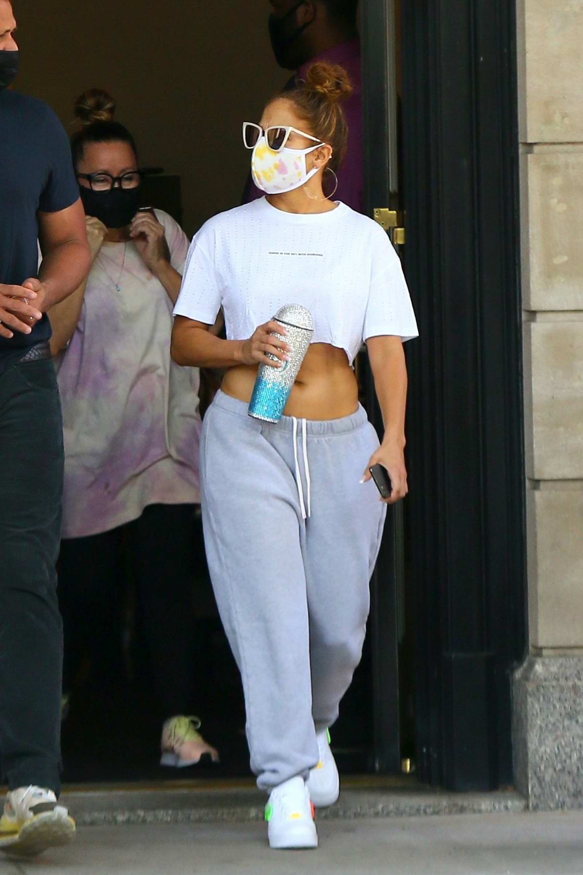 Jennifer Lopez flaunts her toned midriff while leaving her apartment with Alex Rodriguez in Manhattan, New York City