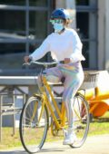 Jennifer Lopez sports a white hoodie and rainbow leggings while biking around the Hamptons, New York