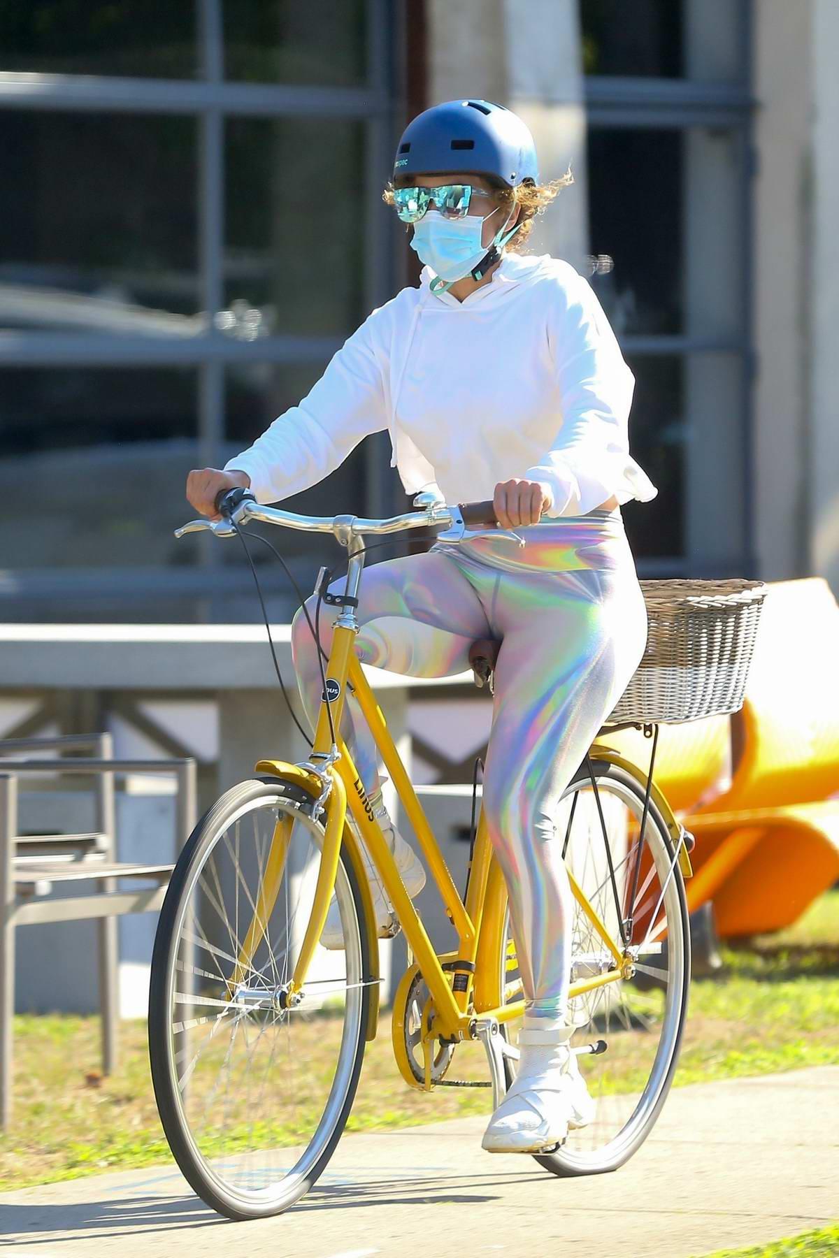 Jennifer Lopez sports a white hoodie and rainbow leggings while biking around the Hamptons, New York