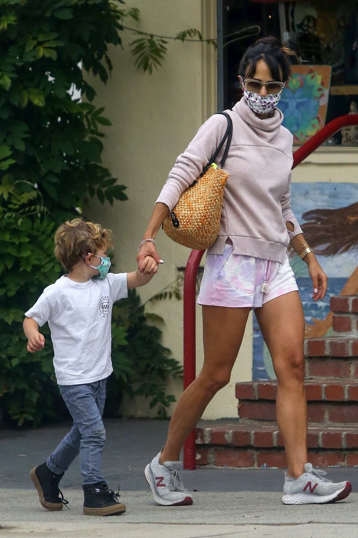 Jordana Brewster dons pink tie-dye shorts as she steps out for a morning smoothie with her son in Los Angeles