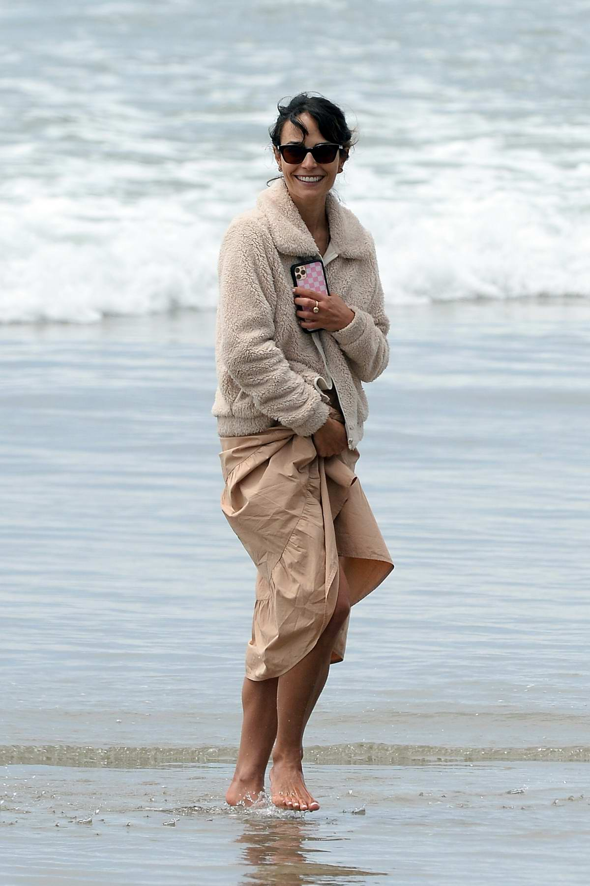 Jordana Brewster is all smiles as she enjoys a stroll on the beach in Malibu, California