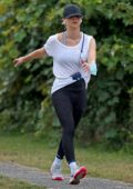 Kaley Cuoco looks fit in a white tee and black leggings as she enjoys a power walk in the Hamptons, New York