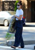 Katie Holmes seen carrying a huge painting in New York City