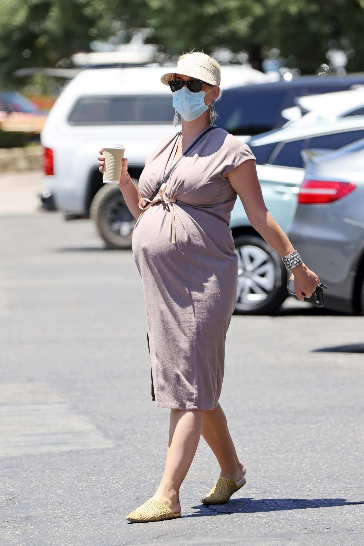 Katy Perry shows her huge baby bump as she picks up food from a cafe in Santa Barbara, California
