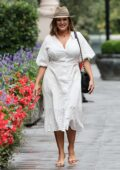 Kelly Brook looks radiant in white summer dress and straw hat at Heart Radio in London, UK