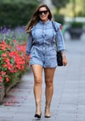 Kelly Brook puts on a leggy display in denim romper while arriving at Global Radio in London, UK