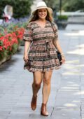 Kelly Brook seen wearing a printed mini dress as she arrives at the Global Radio studios in London, UK