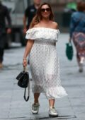 Kelly Brook wears dotted off-the-shoulder summer dress at Heart Radio in London, UK