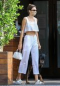 Kendall Jenner goes out for an early dinner with friends and her Doberman at Soho House in Malibu, California