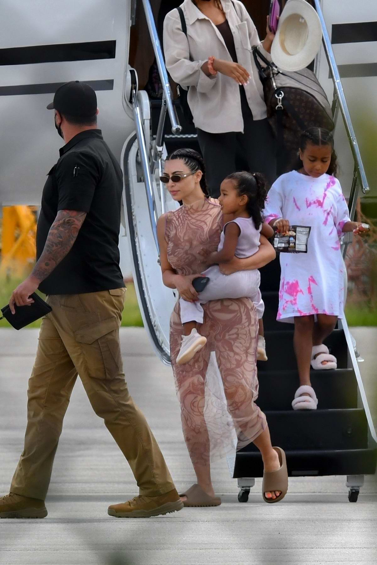 Kim Kardashian and Kanye West arrive back in Miami after spending time in Dominican Republic, Miami, Florida