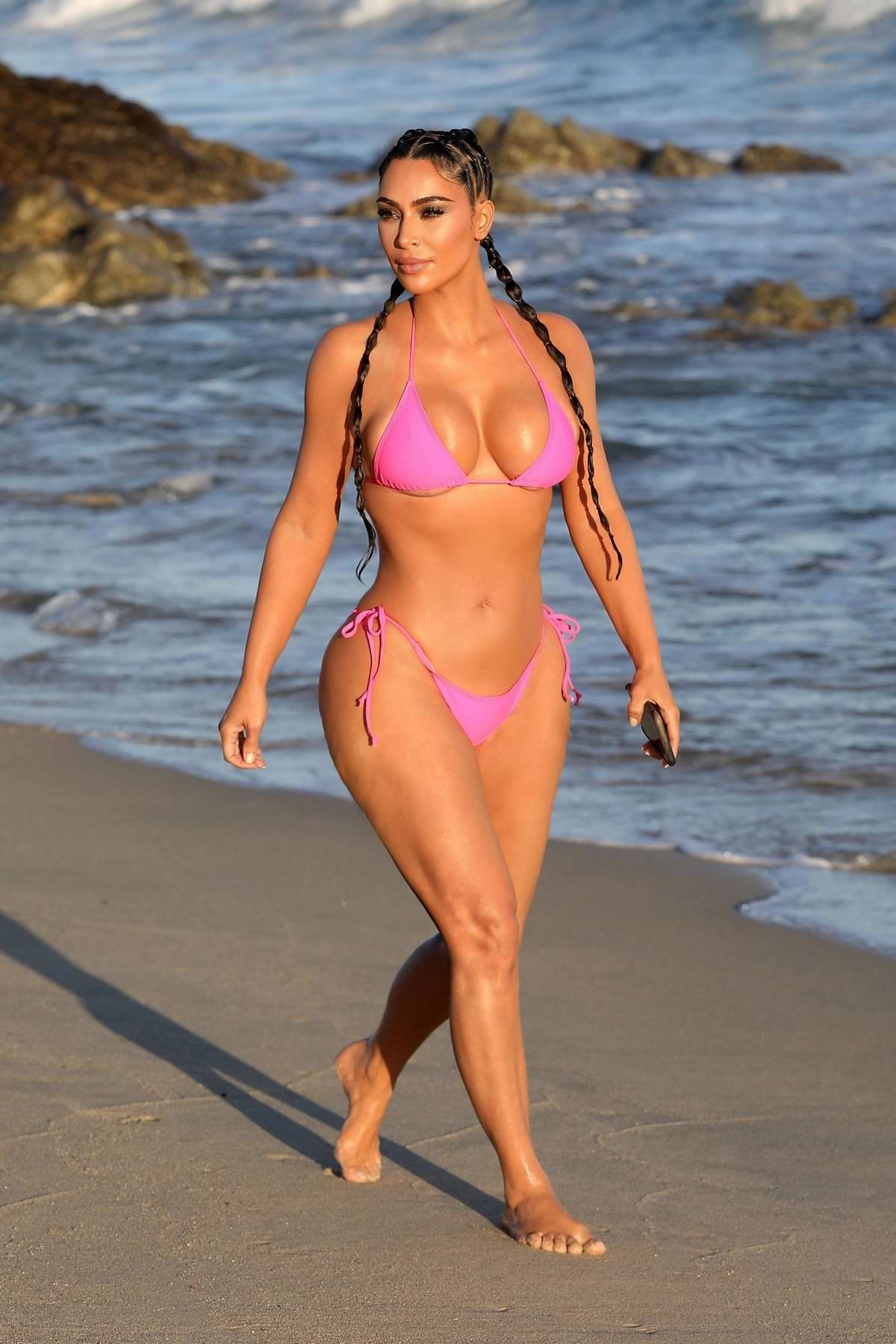 Kim Kardashian puts on a stunning display in a hot pink bikini during a KKW beauty photoshoot in Cabo San Lucas, Mexico