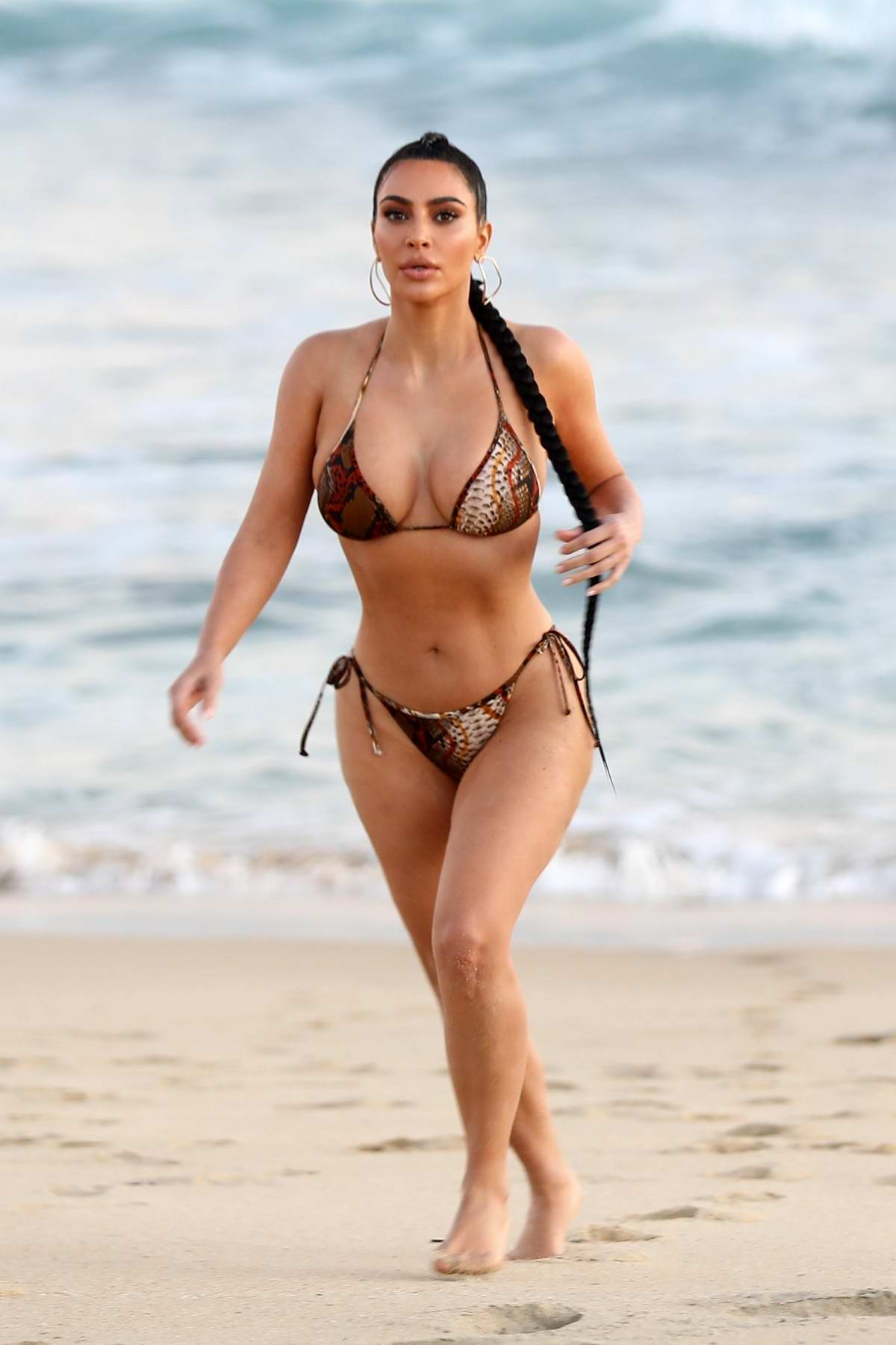 Kim Kardashian shows off her curves in a snakeskin print bikini after filming KUWTK in Malibu, California
