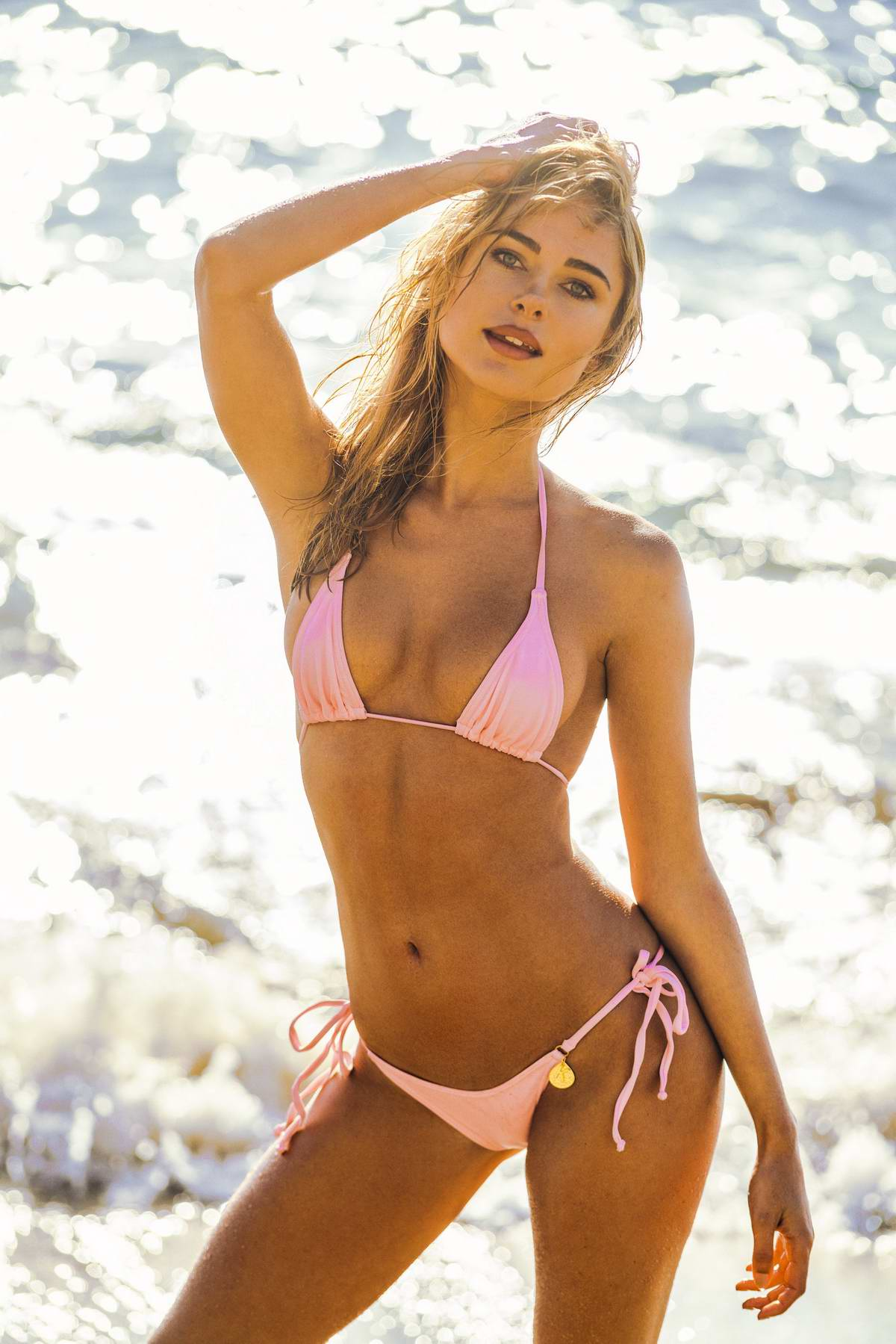Kimberley Garner poses up in a pink bikini during a beach photoshoot in Saint-Tropez, France