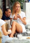 Kimberley Garner stuns in a white mini dress while grabbing lunch with a friend in Chelsea, London, UK