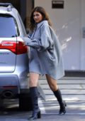 Kylie Jenner rocks an oversized shirt dress and knee-high boots for a meeting in Calabasas, California