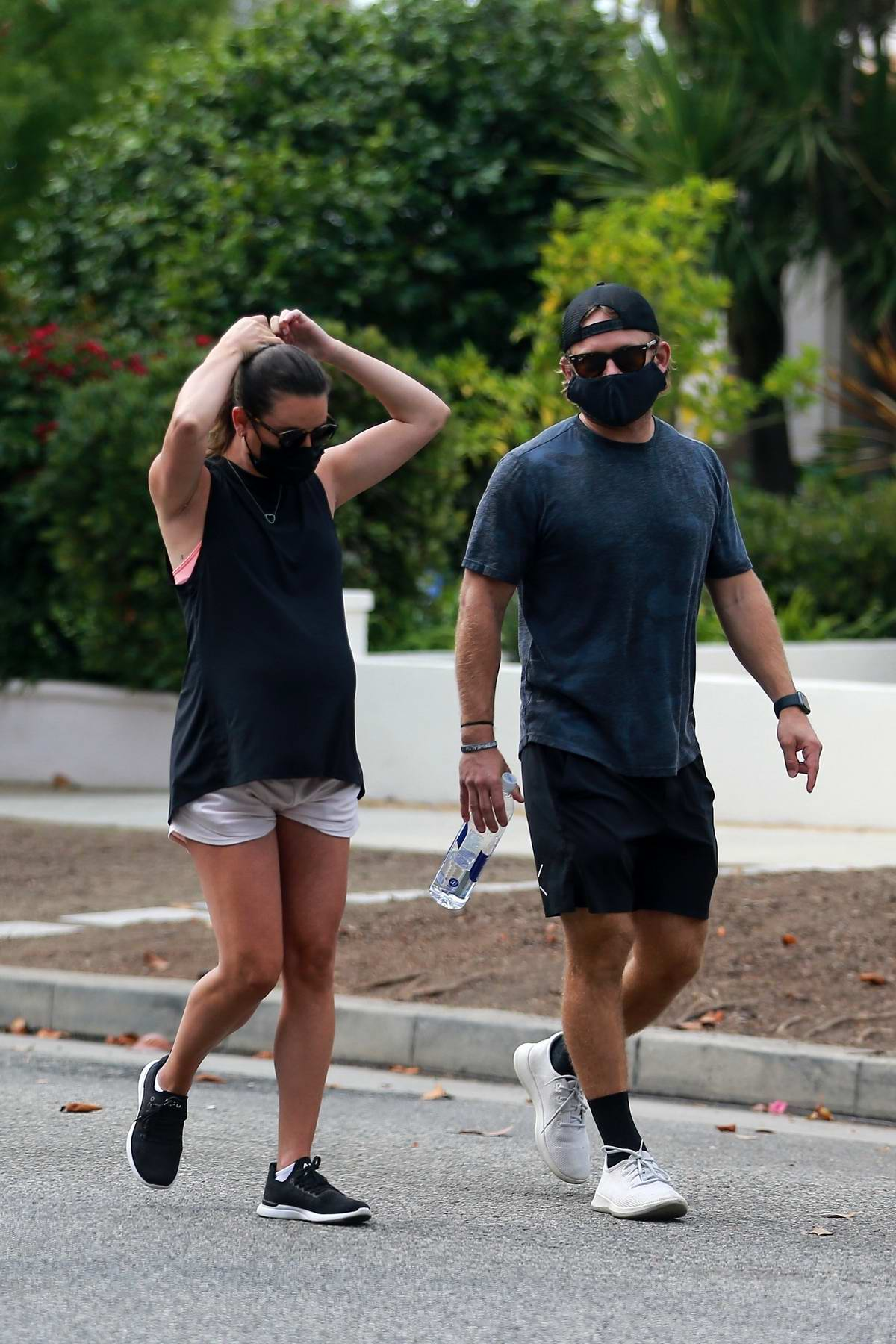Lea Michele enjoys a walk with husband Zandy Reich and her mother in Santa Monica, California
