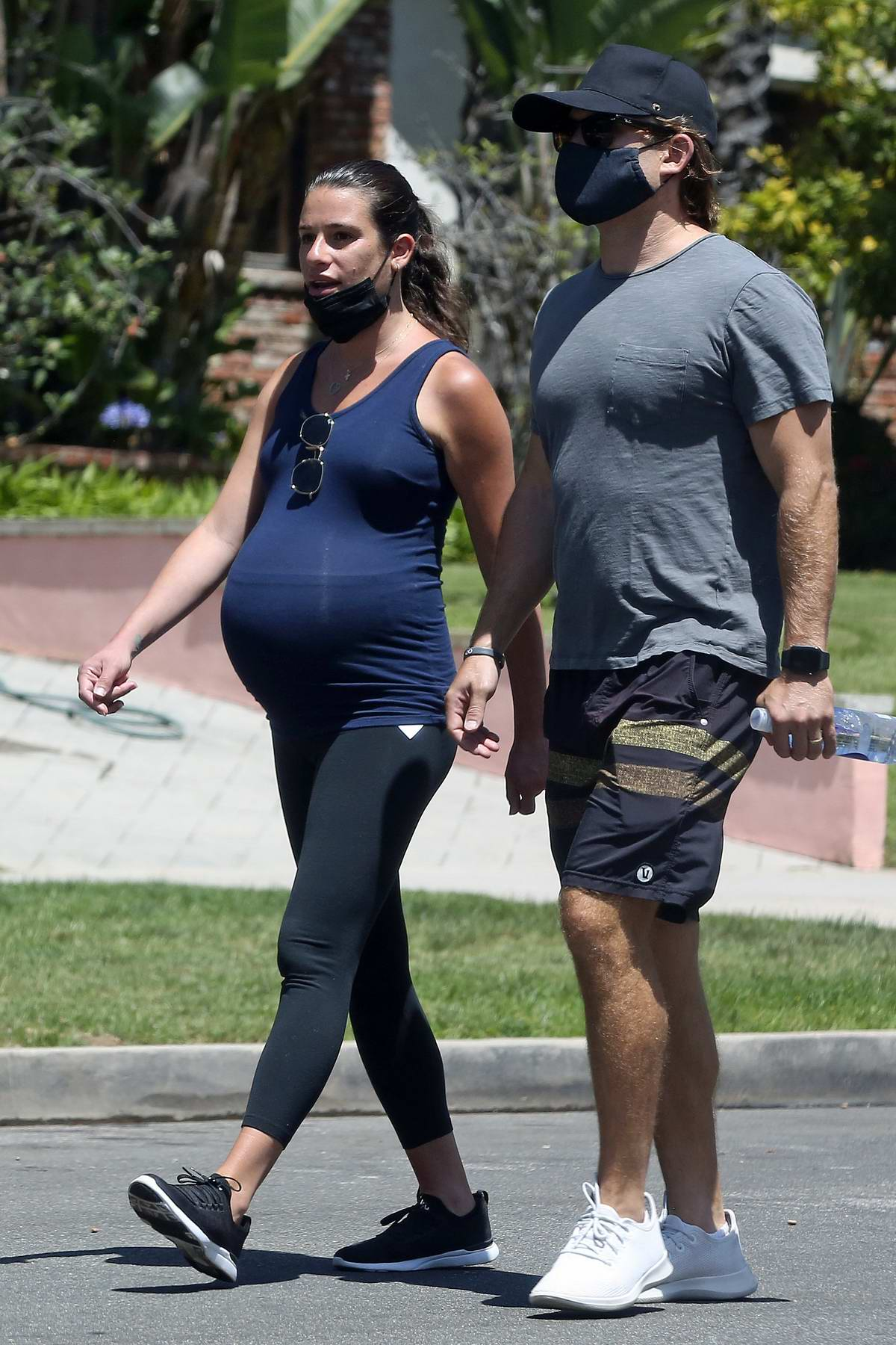 Lea Michele wears tank top and leggings while out for a walk with husband Zandy Reich in Santa Monica, California