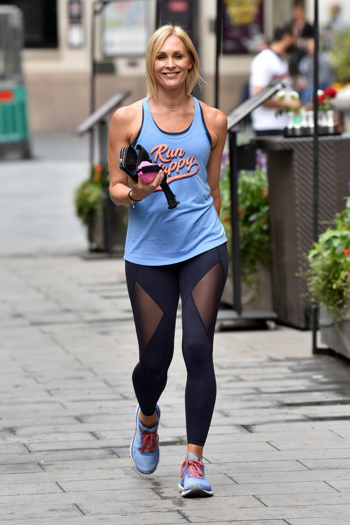Jenni Falconer displays her toned physique in tank top and leggings while leaving the Global Radio in London, UK