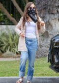 Lily Collins steps out to walk her dog with a friend in Beverly Hills, California