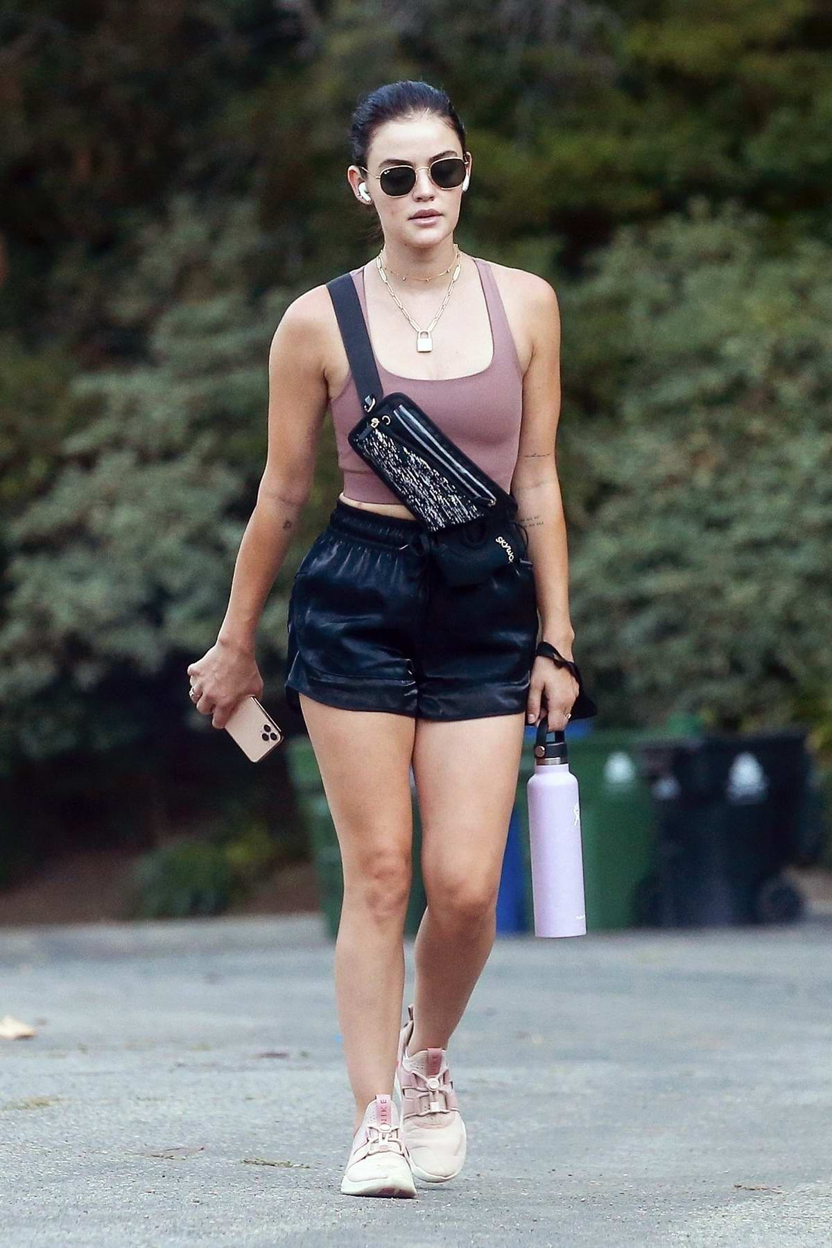 Lucy Hale wears a mauve sports bra and black shorts for her daily hike in Los Angeles