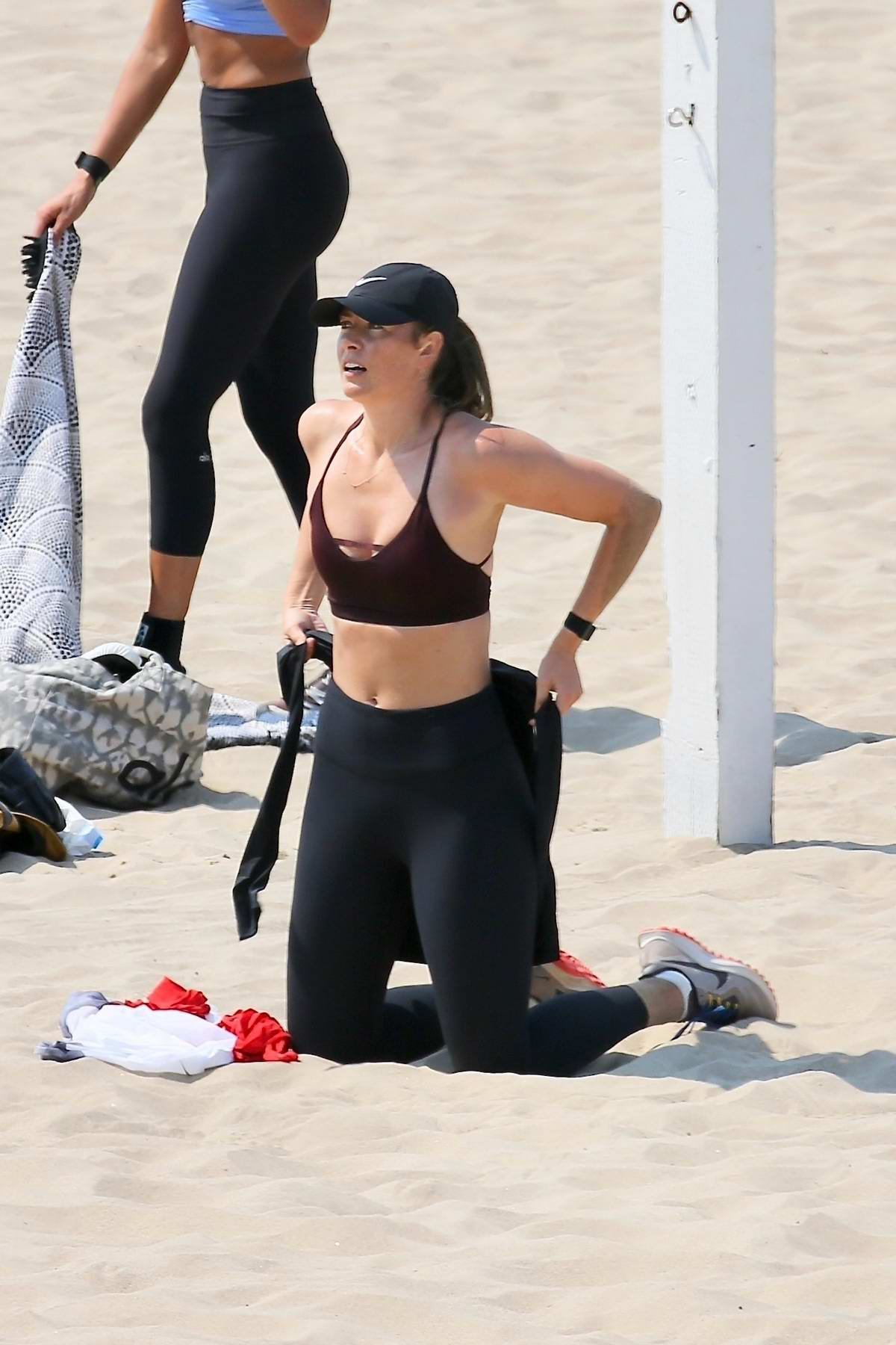 Maria Sharapova shows off her toned figure in sports bra and leggings during a beach workout session in Los Angeles