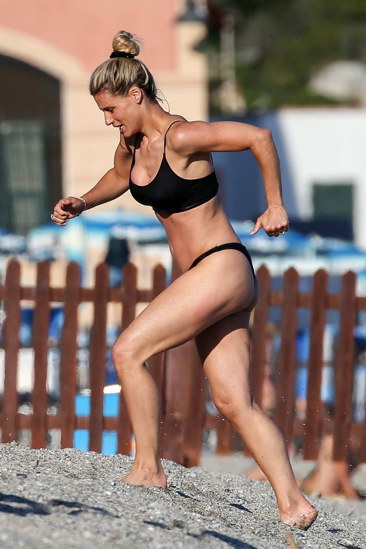 Michelle Hunziker spotted in a black bikini while on the beach with her family in Varigotti, Italy