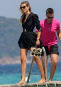 Natasha Poly looks stylish in a black mini dress as she arrives at the Club 55 Beach in Saint-Tropez, France