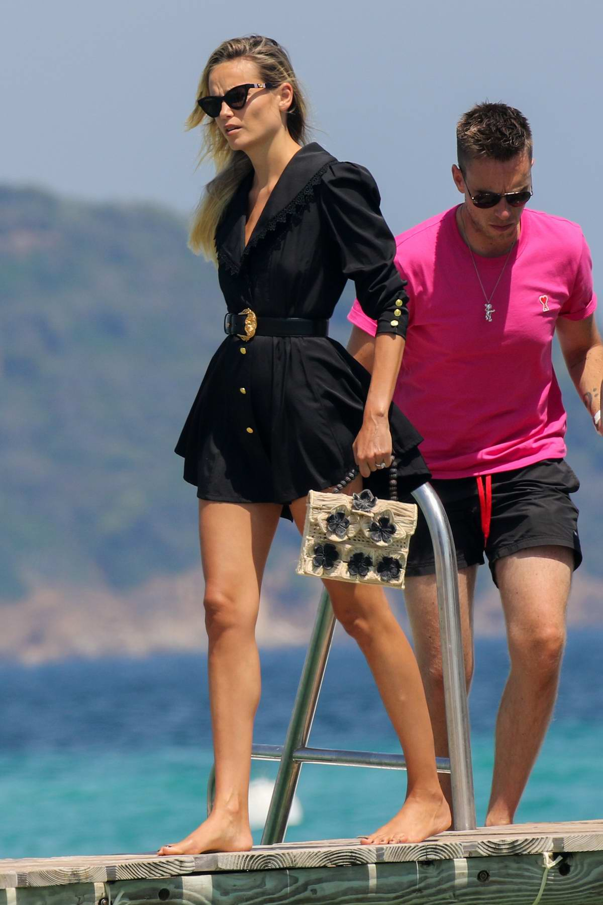Natasha Poly looks stylish in a black mini dress as she arrives at the Club 55 Beach in Saint-Tropez, France