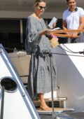 Natasha Poly puts on a protective mask before heading out in Saint-Tropez, France