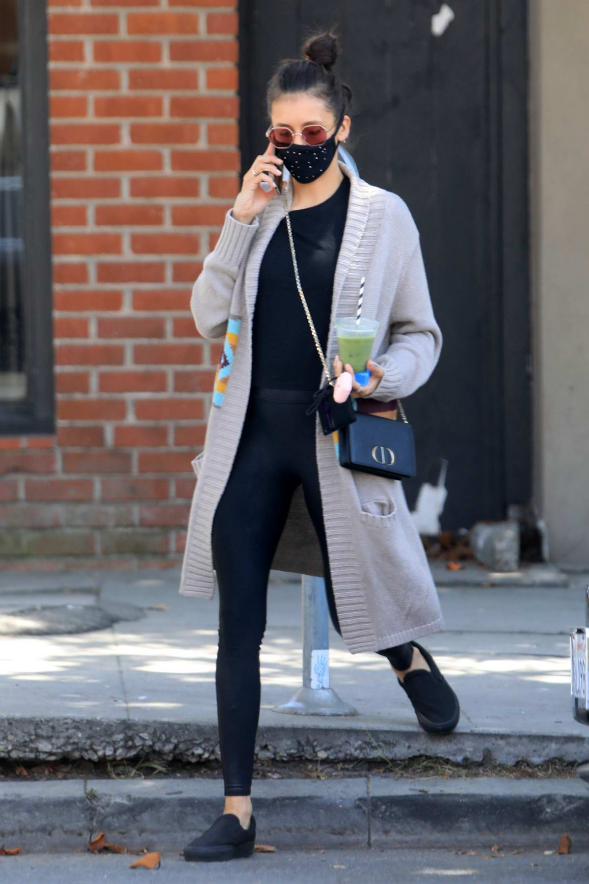 Nina Dobrev picks up a green juice while out running errands in West Hollywood, California